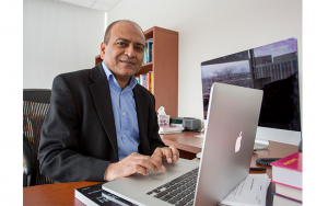 ICS Associate Director Vasant Honavar sits at his desk typing